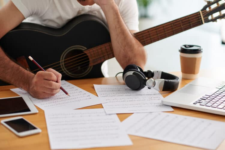 Guitar player writing music for new song
